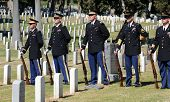 SAN DIEGO, CA - OCTOBER 29, 2008: Honoring The Fallen - Military Honor Guard among headstones at a c