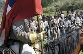 VISTA, CA - MARCH 7: A Confederate Cavalry Soldier holds a flag during Civil War time reenactment in
