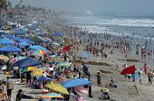 OCEANSIDE, CA - JULY 25: The beach is loaded with people as a heat wave goes  on July 25, 2009 in Oc