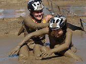 TEMECULA, CALIFORNIA - MARCH 28: Participants slog through mud at the Columbia Sports Muddy Buddy ride and run series at Vail Lake on March 28, 2010 near Temecula, California.