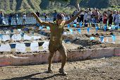 TEMECULA, CALIFORNIA - MARCH 28: Participants slog through mud at the Columbia Sports Muddy Buddy ri