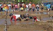 TEMECULA, CALIFORNIA - MARCH 28: Participants slog through mud at the Columbia Sports Muddy Buddy ride and run series at Vail Lake on March 28, 2010 in Temecula, California.