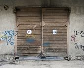 wooden Garage Doors and wall with graffiti
