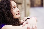 Young beautiful woman portrait, thoughtful gesture.
