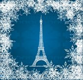 Vector Eiffel Tower with snowflakes on blue knitted background