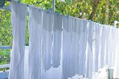White Towels And Sheets Dry In The Sun,  Washing Laundry ,clothes Line,white Clothes Hung Out To Dry poster