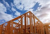 Close-up Of Beam Built Home Under Construction And Blue Sky With Wooden Truss, Post And Beam Framewo poster