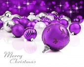 Purple christmas ornaments with star background