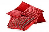 Collection of red cushions on white background