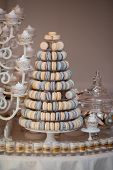 Luxury Wedding Candy Bar Table Set. Macaron Tower Or Pyramid And Cupcakes On Sweet Dessert Table. Pa poster