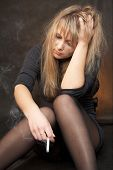 foto of young girls  - Girl is smoking in depression and frustration - JPG