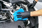 A Man Cleaning Car Engine With Microfiber Cloth. Car Detailing Or Valeting Concept. Selective Focus. poster