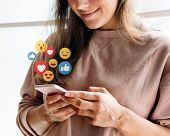 Cheerful woman watching a video live streaming on her phone poster