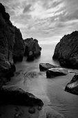 Beautiful Seascape, Ocean and Rocks at Sunset, Black and White Image