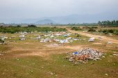 Spontaneous garbage dump in asian countryside poster