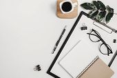 Home Office Workspace Mockup With Blank Clip Board, Office Supplies, Pen, Green Leaf, Coffee Cup On poster