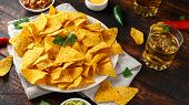 Tortilla Nachos Chips With Cheese Sauce, Guacamole And Tomatoes Salsa Dip. Glass Of Beer. poster