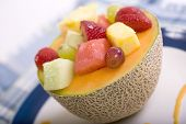 image of fruit bowl  - Fresh Fruit in a Canteloupe Melon Bowl garnished with a Melon Sauce - JPG