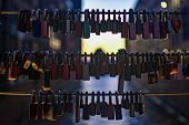 Locks Of Love Blury Lights Background On Valentines Day. Wedding Locks On Rope Bridge Lock Symbol At poster