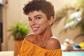 Portrait of natural beautiful girl smiling and looking at camera. Closeup face of brazilian young wo poster