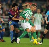 BARCELONA - JAN, 15: Salva Sevilla(R) of Real Betis vies with Sergio Busquets(L) of FC Barcelona dur