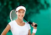 Successful sportswoman with racquet at the tennis court. Healthy lifestyle