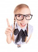 stock photo of school fish  - Funny school girl pointing up - JPG