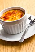 creme brulee in ceramic bowl on kitchen table