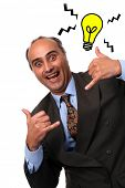 stock photo of feeling stupid  - silly businessman having an idea over white background - JPG