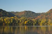 stock photo of winona  - Fall color trees and a reflective lake - JPG