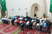 ZAGREB, CROATIA - SEPT 25, 2012. Zagreb Imam leading afternoon prayer in mosque on September 25, 201