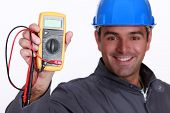 Electrician holding voltmeter