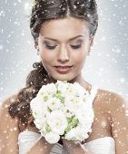 image of bouquet  - Young attractive bride with the bouquet of white roses over snowy Christmas background - JPG