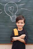 Asian little boy with chalkboard