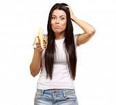 A Young Woman Eating A Banana On White Background