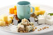 Cheese Plate with Nuts and Sweet Sauce