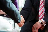 Man shaking hands with manager at job interview closeup cutout employment candidate hiring resume CE