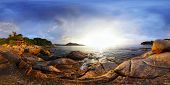 Panorama of a rocky coast of Andaman sea near Laem Sing beach at sunset. Phuket, Thailand