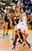 KUALA LUMPUR - OCTOBER 28: Dragons' Loh Shee Fai  #20 scores an easy basket against the Firehorse te