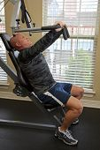 image of gun shot wound  - Solder exercising in gym He suffered gun shot wounds in Iraq and is recovering - JPG