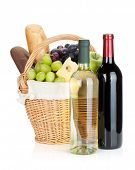 Picnic basket with bread, cheese, grape and wine bottles. Isolated on white background