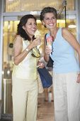 Two women eating ice cream cones
