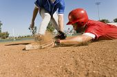View of a runner and an infielder reaching the base