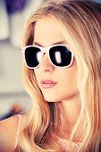 picture of charming  - Charming blonde girl in sunglasses - JPG