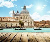 Basilica Santa Maria della Salute, Venice, Italy and wooden surface
