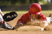 stock photo of infield  - Closeup of a baseball player sliding to the base - JPG