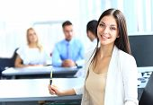 stock photo of ats  - Business woman with her team at the office - JPG