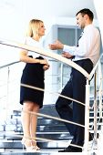 Business partners discussing while on the stairs