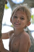 Boy Holding Tree