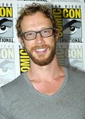 SAN DIEGO, CA - JULY 20: Kris Holden-Ried arrives at the 2013 Comic Con press room at the Hilton San Diego Bayfront hotel on July 20, 2013 in San Diego, CA.